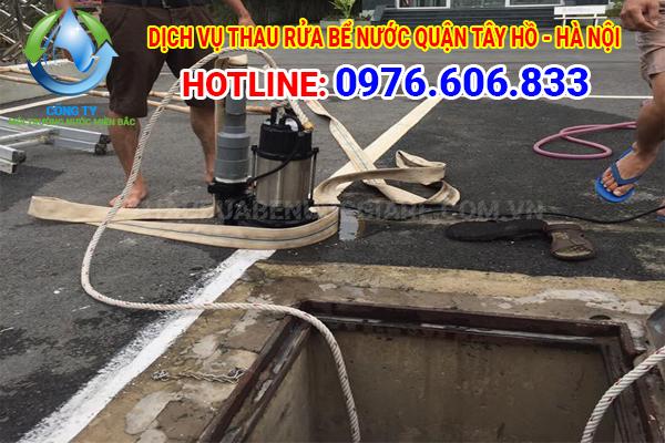Thau rửa bể nước tại quận Tây Hồ, Hà Nội